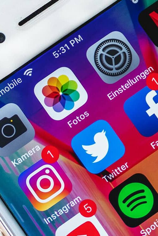 phone with social media marketing icons